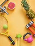Sports equipment and organic food on yellow background. Top view. Motivation Stock Photo