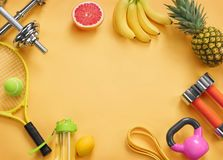 Sports equipment and organic food on yellow background. Top view. Motivation. Copy space Stock Photos