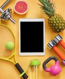Sports equipment and organic food on yellow background. Top view. Motivation Royalty Free Stock Photo