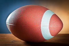 Sports equipment.rugby ball on wood Royalty Free Stock Photos