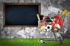 Sports equipment shopping cart stone wall Stock Image