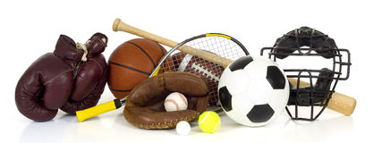 Sports Equipment on White. Variety of sports equipment on white background with copy space, items inlcude boxing gloves, a basketball, a soccer ball, a football Royalty Free Stock Photo