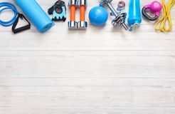 Sports equipment on a white wooden background. Top view. Motivation Royalty Free Stock Image