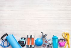 Sports equipment on a white wooden background. Top view. Motivation. Copy space Royalty Free Stock Photography