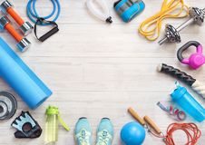 Sports equipment on a white wooden background. Royalty Free Stock Images