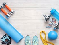 Sports equipment on a white wooden background. Top view. Motivation. Copy space Royalty Free Stock Image