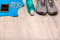 Sports equipment on wooden background. Diet concept Stock Images