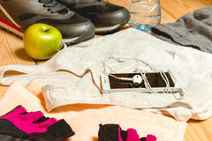 Sports equipment on the wooden floor Royalty Free Stock Photo