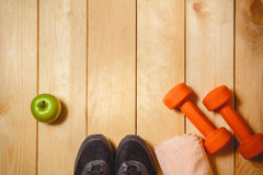 Sports equipment on the wooden floor Royalty Free Stock Image