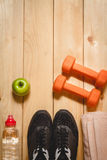 Sports equipment on the wooden floor Royalty Free Stock Photos