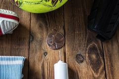 Sports equipment on a wooden bacground stock photo