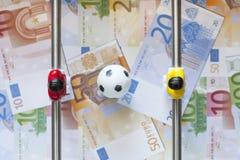 Sports et argent photographie stock