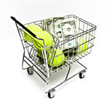 Sports Expenses. Tennis balls and American currency in a small metal cart on white background stock photo