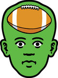 Sports Face. A man's head as an icon of a gridiron inside it Royalty Free Stock Images