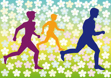 Sports family. Has been running on a flower background Royalty Free Stock Images