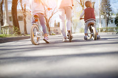 Sports family on bike ride. Family on bike ride in park. Photo from below Stock Photos
