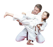 Sports family dad teaches daughter to beat kick leg Stock Photos