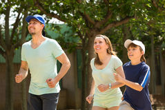Sports family doing running outdoor Stock Image