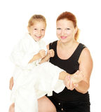 Sports family mom teaches daughter to beat kick insulated Royalty Free Stock Image