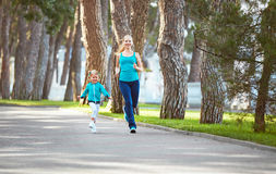 Sports family mother and child daughter are engaged in running a Royalty Free Stock Photos