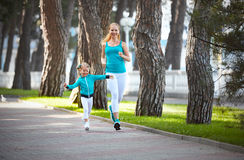 Sports family mother and child daughter are engaged in running a Stock Image