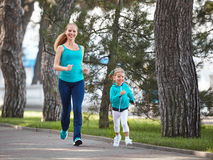 Sports family mother and child daughter are engaged in running a Royalty Free Stock Photography