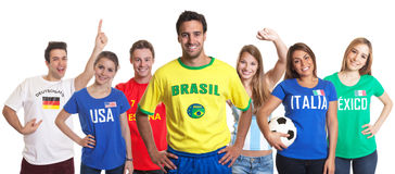 Sports fan from Brazil with fans from other countries Royalty Free Stock Images