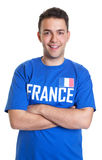 Sports fan from France with crossed arms Royalty Free Stock Images