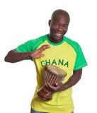 Sports fan from Ghana playing drums Stock Photography