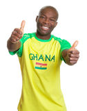 Sports fan from Ghana showing both thumbs Stock Images
