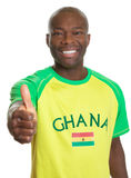 Sports fan from Ghana showing thumb Stock Image