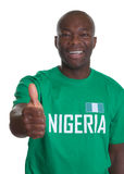 Sports fan from Nigeria showing thumb up Royalty Free Stock Images