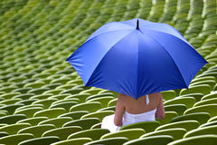 A sports fan with an umbrella Royalty Free Stock Photos