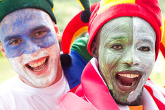 Sports fans. Very excited sports fans with face painted Royalty Free Stock Image