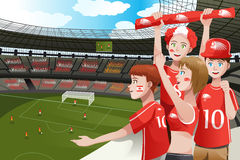 Sports fans in a stadium. A vector illustration of soccer fans cheering inside the stadium Royalty Free Stock Photography