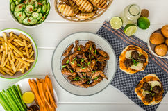 Sports feast - chicken wings, vegetable, french fries, pizza Royalty Free Stock Image