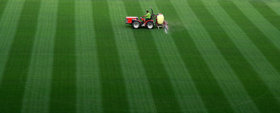 Sports field. Watering on Camp Nou stadium in Barcelona stock photography