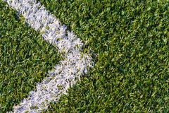 Sports field with artificial grass and white markings as arrow. Top view of sports field with artificial grass and white markings as arrow texture, background Royalty Free Stock Photo