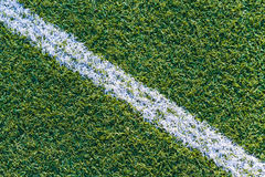 Sports field with artificial grass and white markings. Top view of sports field with artificial grass and white markings texture, background Royalty Free Stock Image