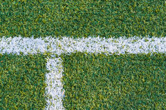 Sports field with artificial grass and white markings. Top view of sports field with artificial grass and white markings texture, background Royalty Free Stock Photo