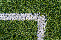 Sports field with artificial grass and white markings. Top view of sports field with artificial grass and white markings texture, background Stock Photos