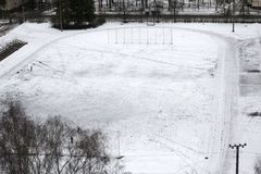 Sports field. The sports field in the city is covered with snow in winter stock photography