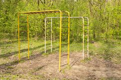 Sports field with horizontal bars in a city park stock images