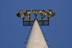 Sports Field Lights. Stadium-style lights, taken at sports fields at a park, looking up, clear blue sky background, daytime so the lights are off Royalty Free Stock Photography
