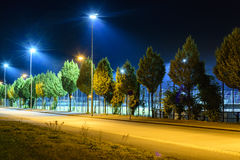 Sports field at night with floodlight lights up. Royalty Free Stock Image
