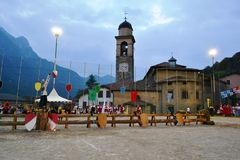 Sports field staged for traditional medieval knight competition. Primaluna/Italy - June 21, 2014: Sports field staged for traditional medieval knight royalty free stock photography