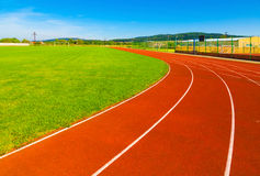 Sports field with synthetic turf and different markings Royalty Free Stock Photo