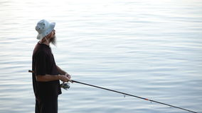 Sports fisherman fishing on Danube river stock video