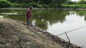 Sports fisherman fishing on lake, using fishing lures; stock video footage