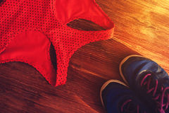 Sports and fitness accessories: sneakers and bra Stock Photos
